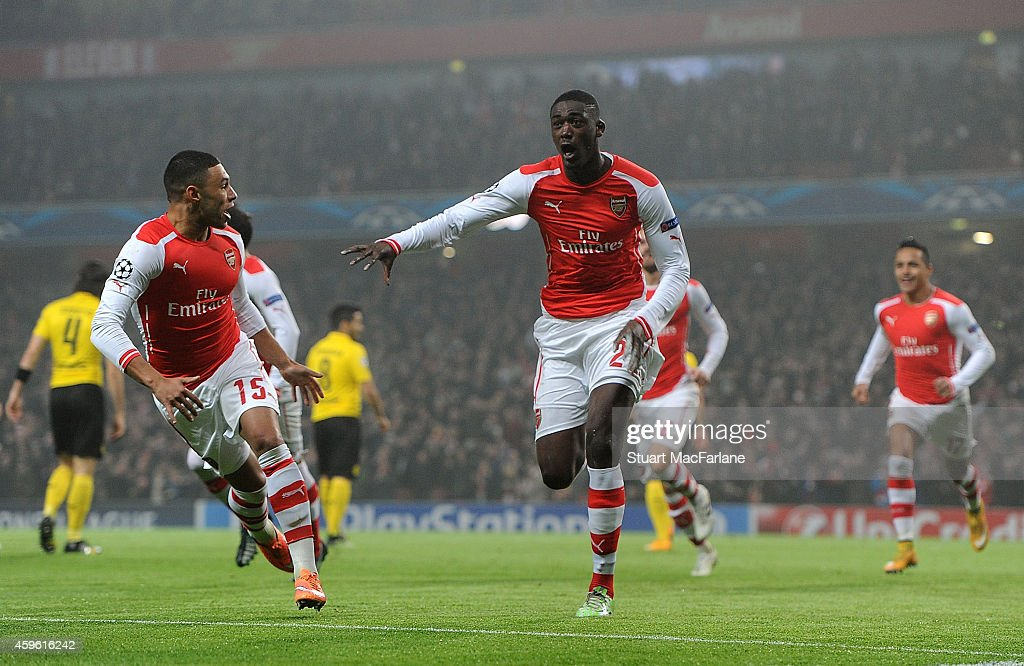 <a gi-track='captionPersonalityLinkClicked' href=/galleries/search?phrase=Yaya+Sanogo&family=editorial&specificpeople=5862550 ng-click='$event.stopPropagation()'>Yaya Sanogo</a> celebrates scoring the Arsenal goal with (L) ALex Oxlade-Chamberlain during the UEFA Champions League match between Arsenal and Borussia Dortmund at Emirates Stadium on November 26, 2014 in London, United Kingdom.