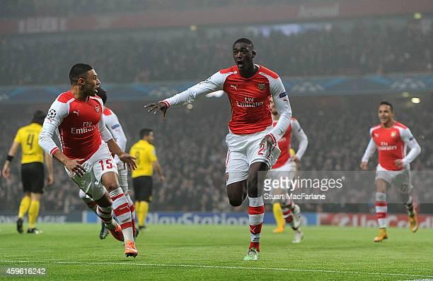 Yaya Sanogo celebrates scoring the Arsenal goal with ALex OxladeChamberlain during the UEFA Champions League match between Arsenal and Borussia...