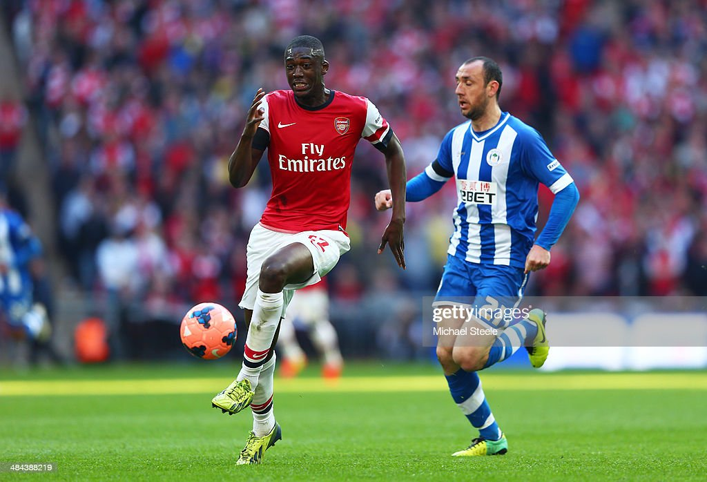 Yaya Sanogo of Arsenal and Ivan Ramis of Wigan Athletic compete for the ball uring the FA Cup SemiFinal match between Wigan Athletic and Arsenal at...