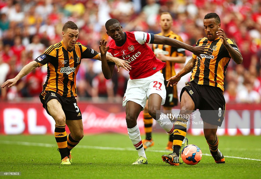 Yaya Sanogo of Arsenal battles for the ball with Tom Huddlestone and James Chester of Hull City during the FA Cup with Budweiser Final match between Arsenal and Hull City at Wembley Stadium on May 17, 2014 in London, England.