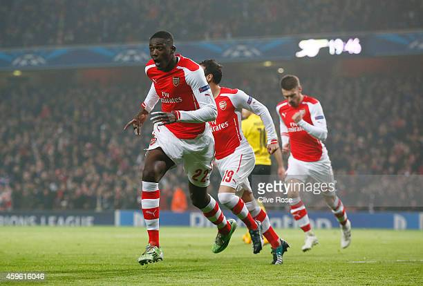 Yaya Sanogo of Arsenal celebrates after scoring the opening goal during the UEFA Champions League Group D match between Arsenal and Borussia Dortmund...
