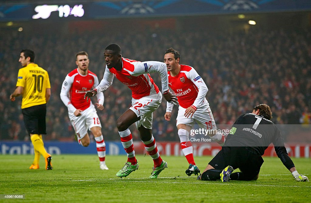 <a gi-track='captionPersonalityLinkClicked' href=/galleries/search?phrase=Yaya+Sanogo&family=editorial&specificpeople=5862550 ng-click='$event.stopPropagation()'>Yaya Sanogo</a> of Arsenal celebrates after scoring the opening goal during the UEFA Champions League Group D match between Arsenal and Borussia Dortmund at the Emirates Stadium on November 26, 2014 in London, United Kingdom.
