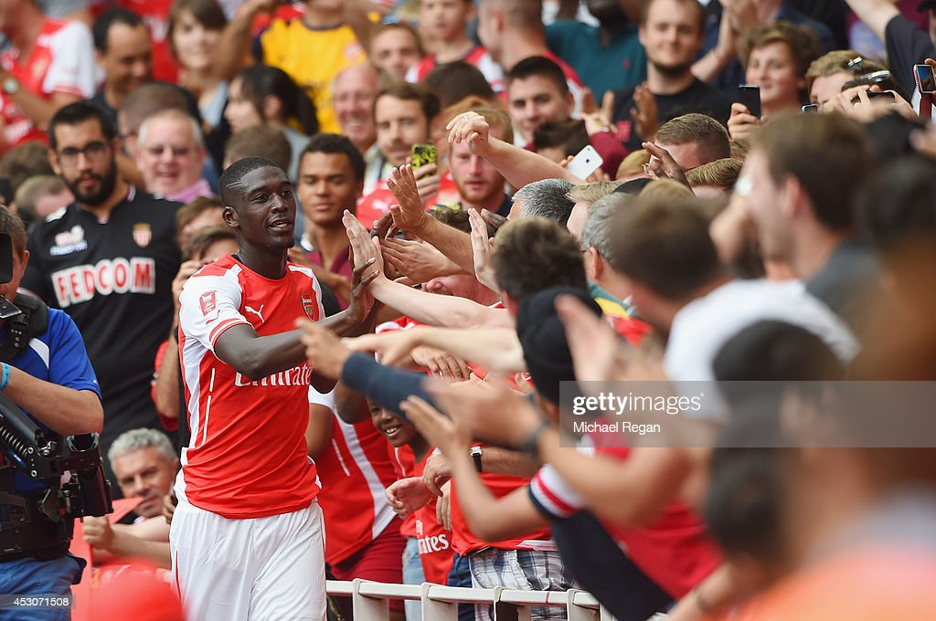 Yaya Sanogo of Arsenal celebrates scoring his 4th goal with fans during the Emirates Cup match between Arsenal and Benfica at the Emirates Stadium on...