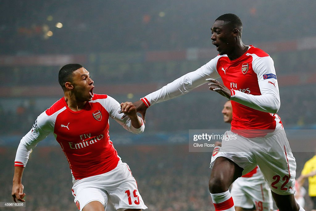 <a gi-track='captionPersonalityLinkClicked' href=/galleries/search?phrase=Yaya+Sanogo&family=editorial&specificpeople=5862550 ng-click='$event.stopPropagation()'>Yaya Sanogo</a> (R) of Arsenal celebrates with teammate <a gi-track='captionPersonalityLinkClicked' href=/galleries/search?phrase=Alex+Oxlade-Chamberlain&family=editorial&specificpeople=7191518 ng-click='$event.stopPropagation()'>Alex Oxlade-Chamberlain</a> (L) after scoring the opening goal during the UEFA Champions League Group D match between Arsenal and Borussia Dortmund at the Emirates Stadium on November 26, 2014 in London, United Kingdom.