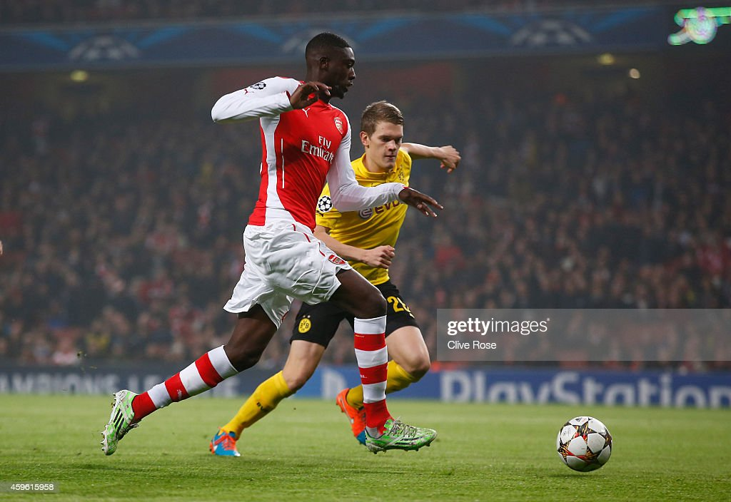 <a gi-track='captionPersonalityLinkClicked' href=/galleries/search?phrase=Yaya+Sanogo&family=editorial&specificpeople=5862550 ng-click='$event.stopPropagation()'>Yaya Sanogo</a> of Arsenal goes past <a gi-track='captionPersonalityLinkClicked' href=/galleries/search?phrase=Matthias+Ginter&family=editorial&specificpeople=8616925 ng-click='$event.stopPropagation()'>Matthias Ginter</a> of Borussia Dortmund to score the opening goal during the UEFA Champions League Group D match between Arsenal and Borussia Dortmund at the Emirates Stadium on November 26, 2014 in London, United Kingdom.