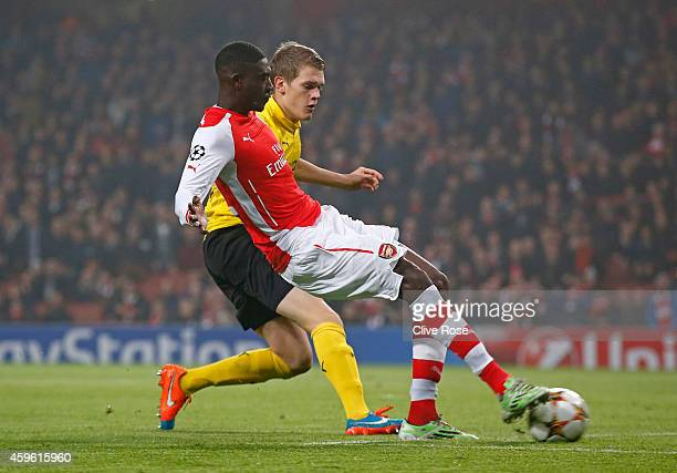Yaya Sanogo of Arsenal goes past Matthias Ginter of Borussia Dortmund to score the opening goal during the UEFA Champions League Group D match...
