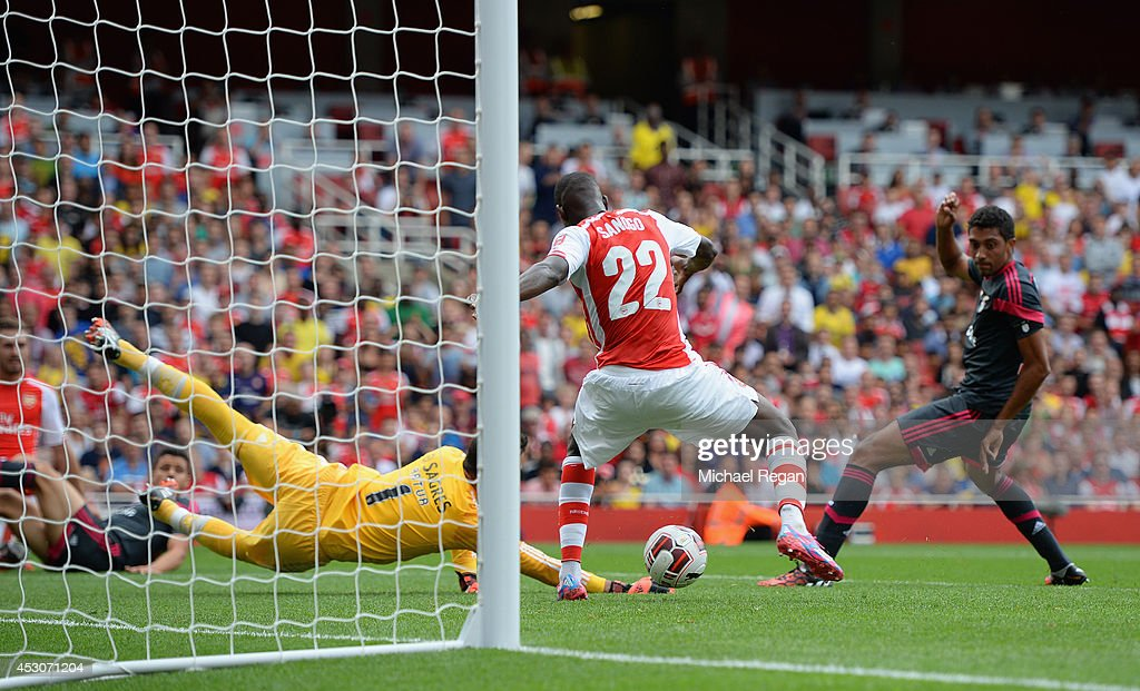 Yaya Sanogo of Arsenal scores his first goal during the Emirates Cup match between Arsenal and Benfica at the Emirates Stadium on August 2, 2014 in London, England.