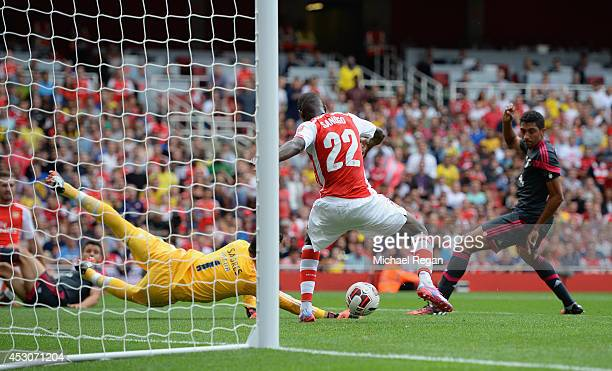 Yaya Sanogo of Arsenal scores his first goal during the Emirates Cup match between Arsenal and Benfica at the Emirates Stadium on August 2 2014 in...