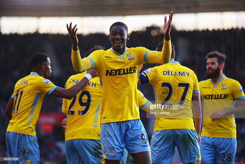 <a gi-track='captionPersonalityLinkClicked' href=/galleries/search?phrase=Yaya+Sanogo&family=editorial&specificpeople=5862550 ng-click='$event.stopPropagation()'>Yaya Sanogo</a> of Crystal Palace (9) celebrates as <a gi-track='captionPersonalityLinkClicked' href=/galleries/search?phrase=Marouane+Chamakh&family=editorial&specificpeople=727555 ng-click='$event.stopPropagation()'>Marouane Chamakh</a> (obscured) scores their third goal during the FA Cup Fourth Round match between Southampton and Crystal Palace at St Mary's Stadium on January 24, 2015 in Southampton, England.