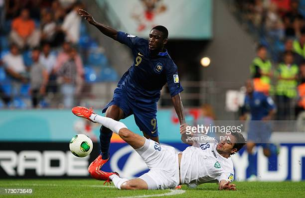 Yaya Sanogo of France and Kamranbey Kapadze of Uzbekistan compete for the ball during the FIFA U20 World Cup Quarter Final match between France and...