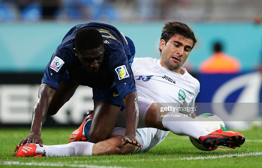 <a gi-track='captionPersonalityLinkClicked' href=/galleries/search?phrase=Yaya+Sanogo&family=editorial&specificpeople=5862550 ng-click='$event.stopPropagation()'>Yaya Sanogo</a> (L) of France and Kamranbey Kapadze of Uzbekistan compete for the ball during the FIFA U-20 World Cup Quarter Final match between France and Uzbekistan at Yeni Sehir Stadium on July 6, 2013 in Rize, Turkey.
