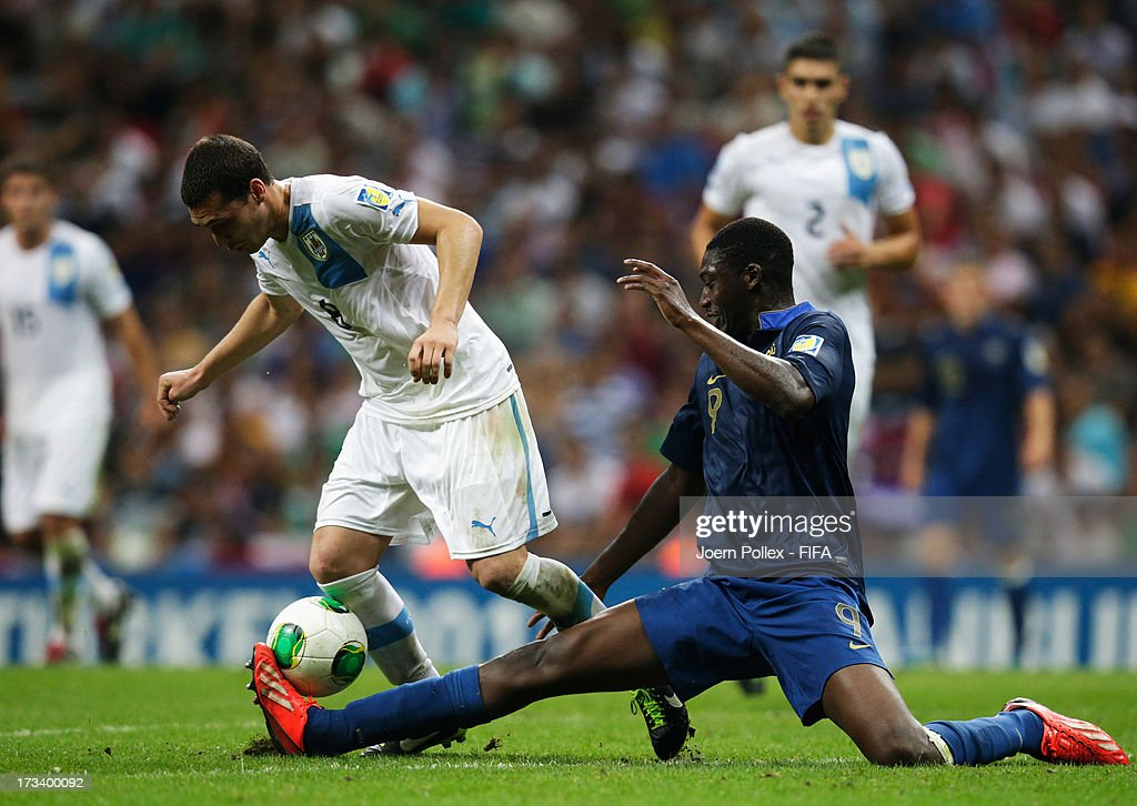 <a gi-track='captionPersonalityLinkClicked' href=/galleries/search?phrase=Yaya+Sanogo&family=editorial&specificpeople=5862550 ng-click='$event.stopPropagation()'>Yaya Sanogo</a> (R) of France and Sebastian Cristoforo of Uruguay compete for the ball during the FIFA U-20 World Cup Final match between France and Uruguay at Ali Sami Yen Arena on July 13, 2013 in Istanbul, Turkey.
