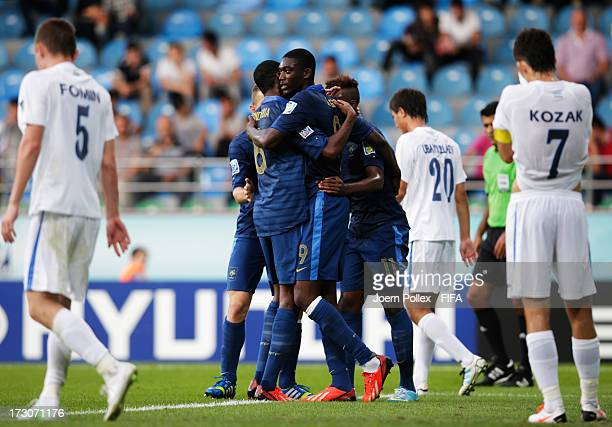 Yaya Sanogo of France celebrates with his team mates after scoring his team's first goal during the FIFA U20 World Cup Quarter Final match between...