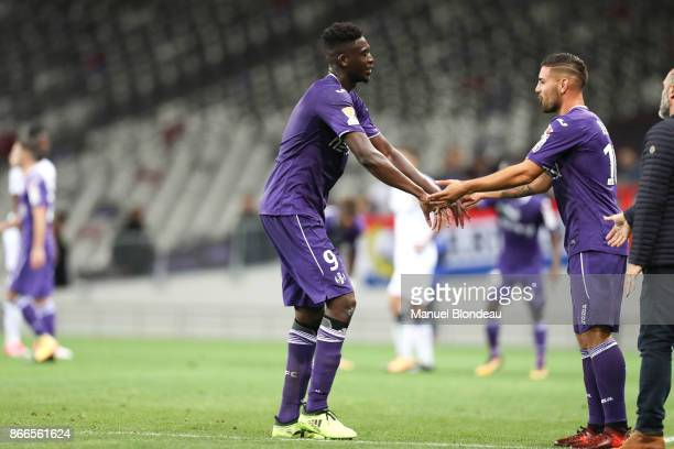 Yaya Sanogo of Toulouse shakes hands with Andy Delort as he is substituted during the French League Cup match between Toulouse and Clermont on...