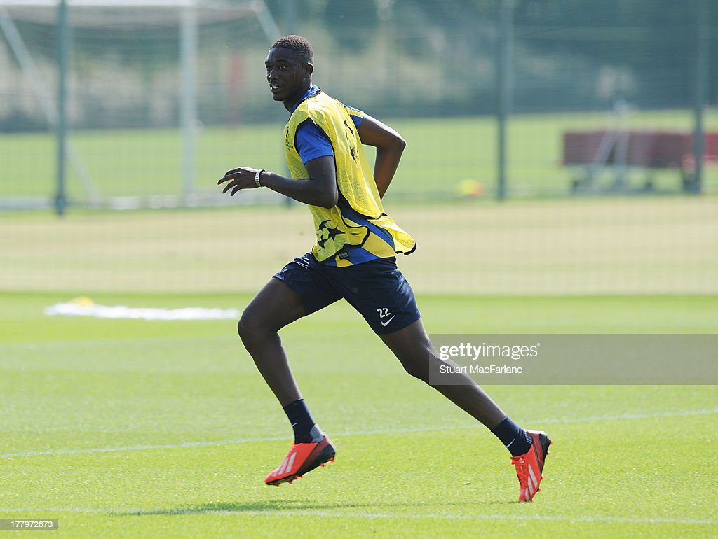 Yaya Sanong of Arsenal during a training session ahead of their UEFA Champions League Play Off second leg match against Fenerbache at London Colney on August 26, 2013 in St Albans, England.