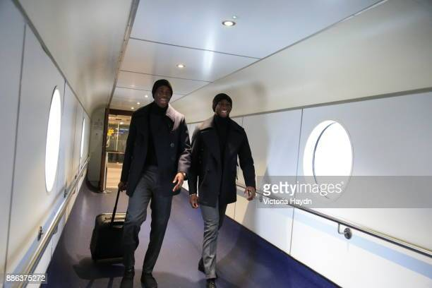 Yaya Toure and Eliaquim Mangala board the flight to Kharkiv to face Shakhtar Donetsk in the Champions League on December 4 2017 in Manchester England