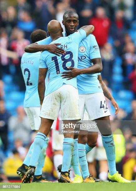 Yaya Toure and Fabian Delph of Manchester City embrace following the Premier League match between Manchester City and Stoke City at Etihad Stadium on...