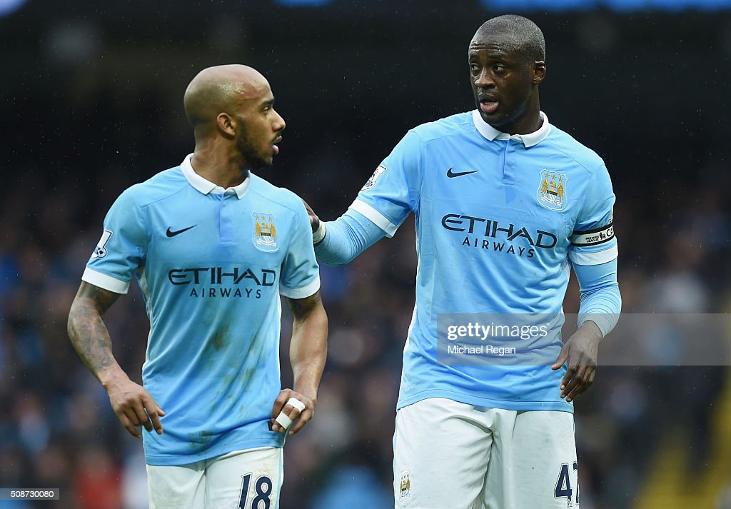 <a gi-track='captionPersonalityLinkClicked' href=/galleries/search?phrase=Yaya+Toure&family=editorial&specificpeople=550817 ng-click='$event.stopPropagation()'>Yaya Toure</a> (R) and <a gi-track='captionPersonalityLinkClicked' href=/galleries/search?phrase=Fabian+Delph&family=editorial&specificpeople=5443479 ng-click='$event.stopPropagation()'>Fabian Delph</a> (L) of Manchester City talk during the Barclays Premier League match between Manchester City and Leicester City at the Etihad Stadium on February 6, 2016 in Manchester, England.