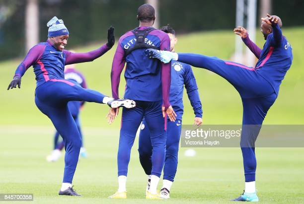 Yaya Toure loses the ball and gets kicked by Benjamin Mendy and Eliaquim Mangala at Manchester City Football Academy on September 11 2017 in...