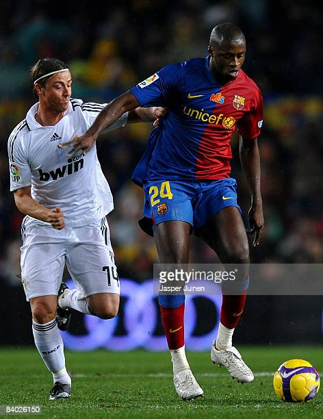 Yaya Toure of Barcelona duels for the ball with Jose Maria Gutierrez of Real Madrid during the La Liga match between Barcelona and Real Madrid at the...