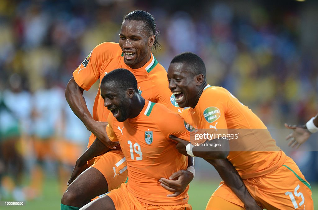 AFRICA - JANUARY 26, Yaya Toure (M) of Ivory Coast celebrates scoring a goal with Didier Drogba and Max Gradel during the 2013 African Cup of Nations match between Ivory Coast and Tunisia at Royal Bafokeng Stadium on January 26, 2013 in Rustenburg, South Africa.