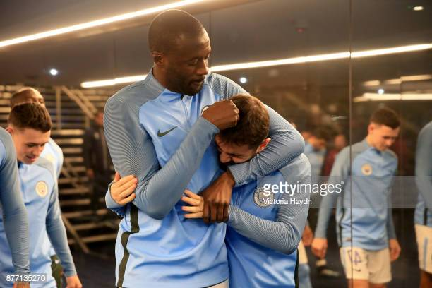 Yaya Toure of Manchester City and Bernardo Silva of Manchester City share a joke prior to the UEFA Champions League group F match between Manchester...