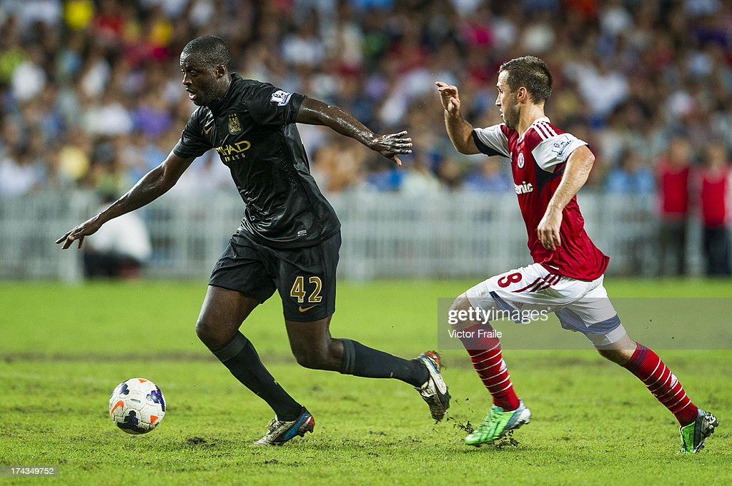 <a gi-track='captionPersonalityLinkClicked' href=/galleries/search?phrase=Yaya+Toure&family=editorial&specificpeople=550817 ng-click='$event.stopPropagation()'>Yaya Toure</a> (L) of Manchester City and Carlos Augusto Bertoldi of South China during the Barclays Asia Trophy Semi Final match between Manchester City and South China at Hong Kong Stadium on July 24, 2013 in So Kon Po, Hong Kong.