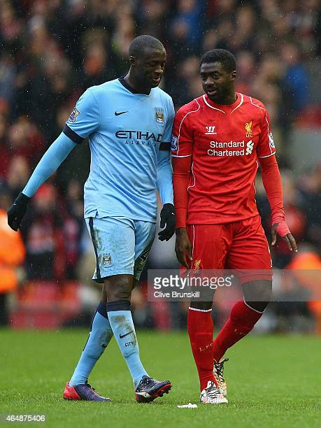 Yaya Toure of Manchester City and Kolo Toure of Liverpool walk off the pitch after the Barclays Premier League match between Liverpool and Manchester...