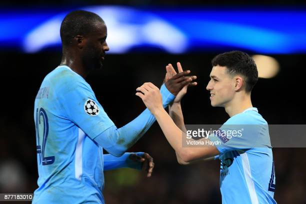 Yaya Toure of Manchester City and Phil Foden of Manchester City shake hands when Phil Foden of Manchester City is being substituted during the UEFA...