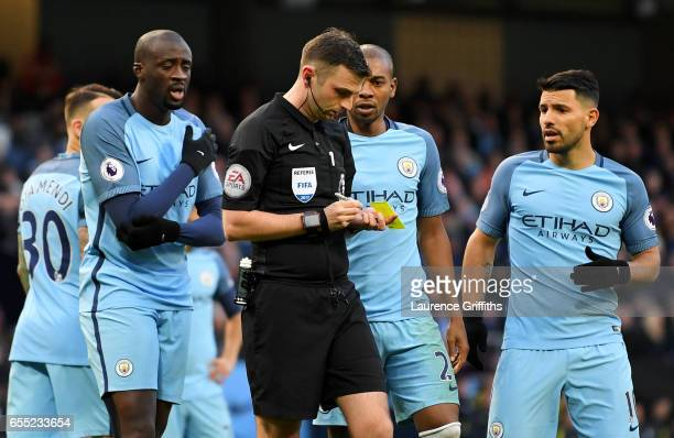 Yaya Toure of Manchester City and Sergio Aguero of Manchester City argue with referee Michael Oliver after he awards Liverpool a penalty during the...