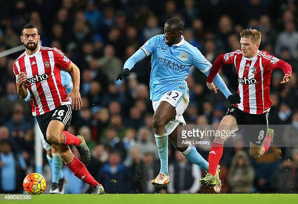 Yaya Toure of Manchester City and Steven Davis of Southampton compete for the ball during the Barclays Premier League match between Manchester City...
