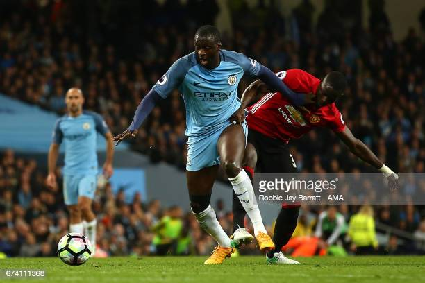 Yaya Toure of Manchester City battles with Eric Bailly of Manchester United during the Premier League match between Manchester City and Manchester...