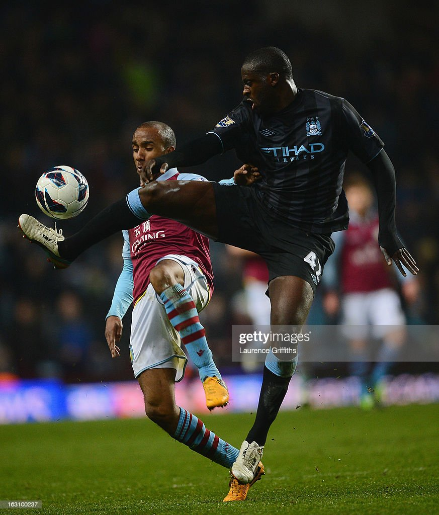 <a gi-track='captionPersonalityLinkClicked' href=/galleries/search?phrase=Yaya+Toure&family=editorial&specificpeople=550817 ng-click='$event.stopPropagation()'>Yaya Toure</a> of Manchester City battles with <a gi-track='captionPersonalityLinkClicked' href=/galleries/search?phrase=Fabian+Delph&family=editorial&specificpeople=5443479 ng-click='$event.stopPropagation()'>Fabian Delph</a> of Aston Villa during the Barclays Premier League match between Aston Villa and Manchester City at Villa Park on March 4, 2013 in Birmingham, England.