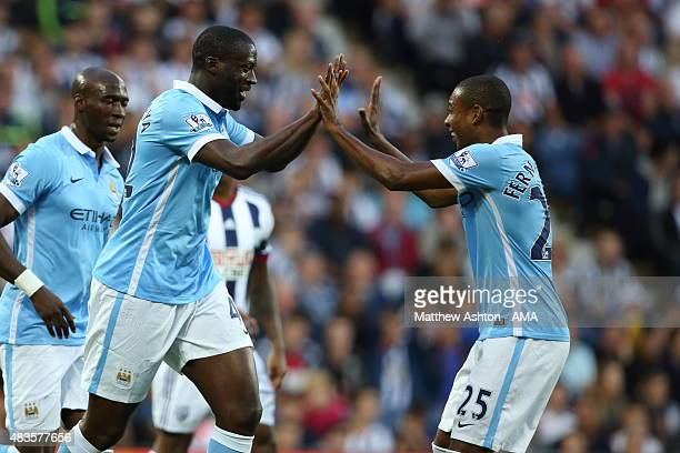 Yaya Toure of Manchester City celebrates after scoring a goal to make it 01 with Fernandinho during the Barclays Premier League match between West...