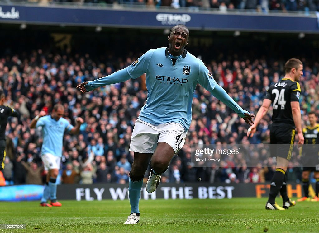 <a gi-track='captionPersonalityLinkClicked' href=/galleries/search?phrase=Yaya+Toure&family=editorial&specificpeople=550817 ng-click='$event.stopPropagation()'>Yaya Toure</a> of Manchester City celebrates after scoring the opening goal during the Barclays Premier League match between Manchester City and Chelsea at Etihad Stadium on February 24, 2013 in Manchester, England.