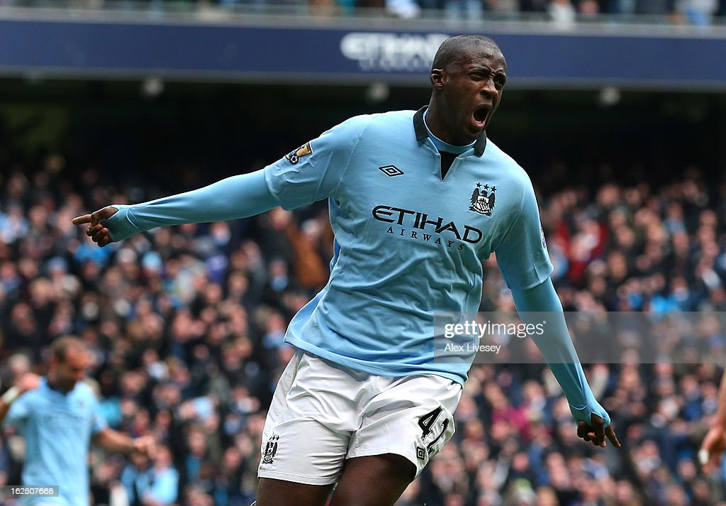 Yaya Toure of Manchester City celebrates after scoring the opening goal during the Barclays Premier League match between Manchester City and Chelsea at Etihad Stadium on February 24, 2013 in Manchester, England.