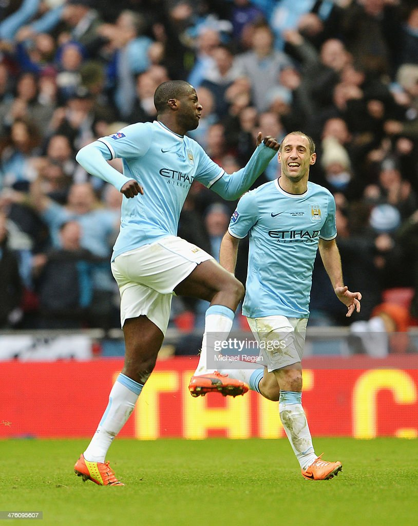 <a gi-track='captionPersonalityLinkClicked' href=/galleries/search?phrase=Yaya+Toure&family=editorial&specificpeople=550817 ng-click='$event.stopPropagation()'>Yaya Toure</a> (L) of Manchester City celebrates his goal with Pablo Zabaleta of Manchester City during the Capital One Cup Final between Manchester City and Sunderland at Wembley Stadium on March 2, 2014 in London, England.