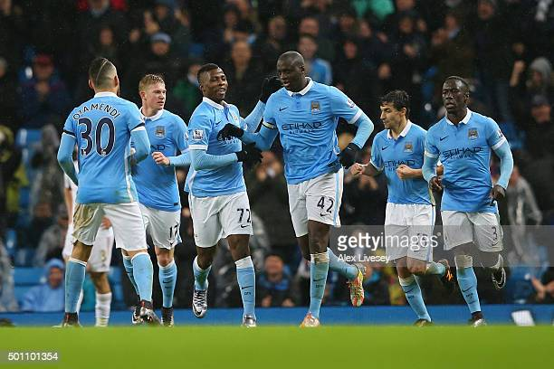 Yaya Toure of Manchester City celebrates his team's second goal with his team mates during the Barclays Premier League match between Manchester City...
