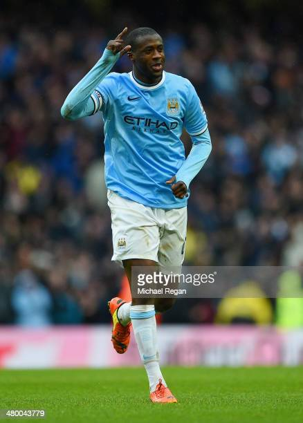Yaya Toure of Manchester City celebrates scoring his hat trick during the Barclays Premier League match between Manchester City and Fulham at Etihad...