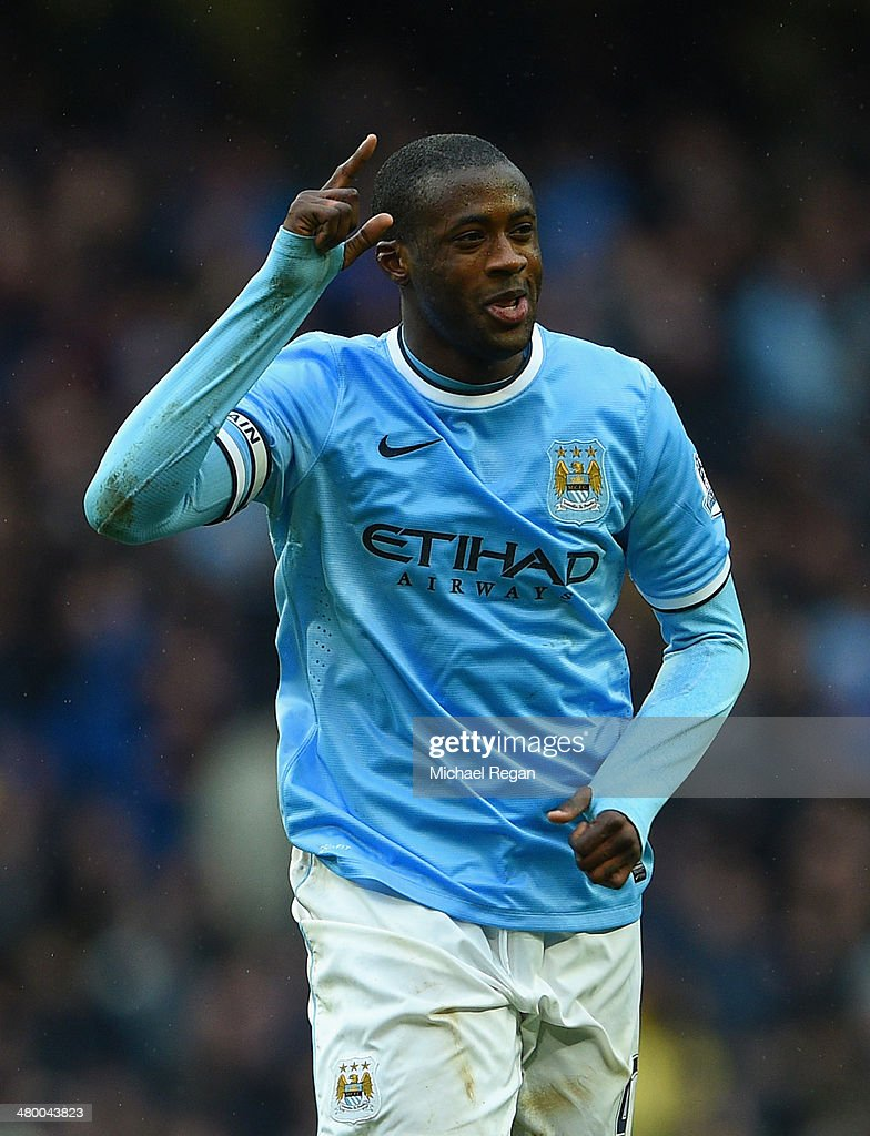 <a gi-track='captionPersonalityLinkClicked' href=/galleries/search?phrase=Yaya+Toure&family=editorial&specificpeople=550817 ng-click='$event.stopPropagation()'>Yaya Toure</a> of Manchester City celebrates scoring his hat trick during the Barclays Premier League match between Manchester City and Fulham at Etihad Stadium on March 22, 2014 in Manchester, England.