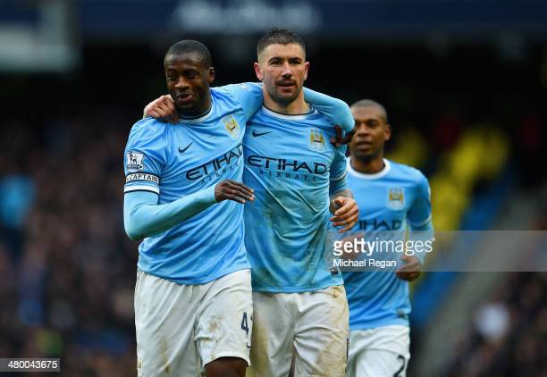 Yaya Toure of Manchester City celebrates scoring his hat trick with Aleksandar Kolarov of Manchester City during the Barclays Premier League match...