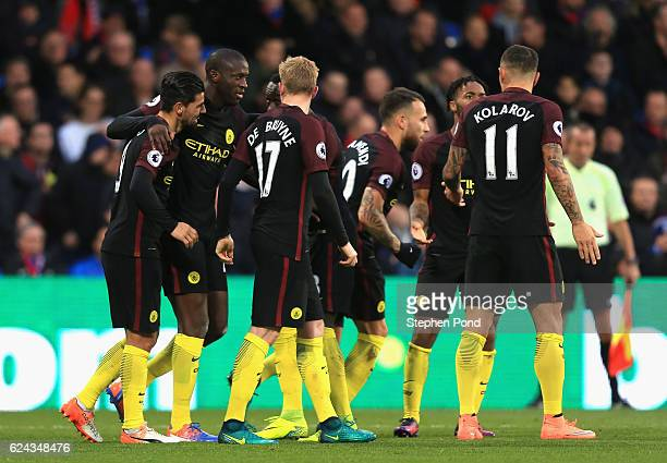 Yaya Toure of Manchester City celebrates scoring his sides first goal with his Manchester City team mates during the Premier League match between...