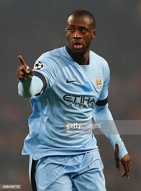 Yaya Toure of Manchester City celebrates scoring his team's first goal during the UEFA Champions League Group E match between Manchester City and...