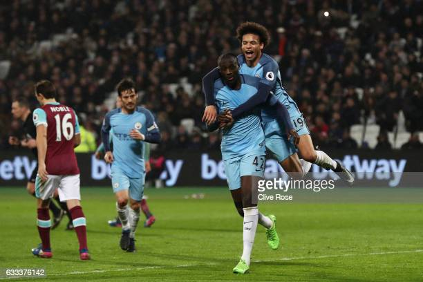 Yaya Toure of Manchester City celebrates scoring his team's fourth goal with Leroy Sane during the Premier League match between West Ham United and...