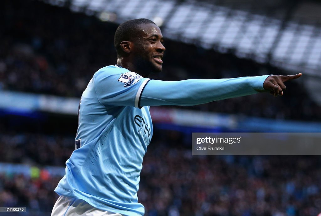 <a gi-track='captionPersonalityLinkClicked' href=/galleries/search?phrase=Yaya+Toure&family=editorial&specificpeople=550817 ng-click='$event.stopPropagation()'>Yaya Toure</a> of Manchester City celebrates scoring the opening goal during the Barclays Premier League match between Manchester City and Stoke City at the Etihad Stadium on February 22, 2014 in Manchester, England.