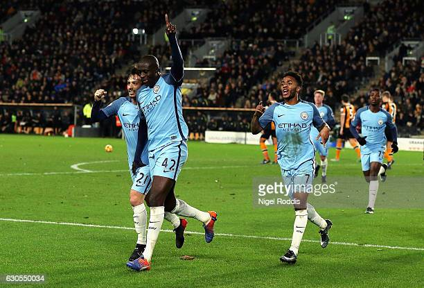 Yaya Toure of Manchester City celebrates scoring the opening goal with David Silva during the Premier League match between Hull City and Manchester...