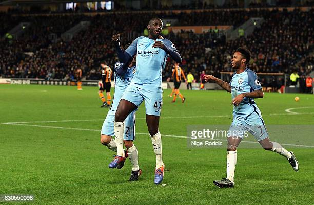 Yaya Toure of Manchester City celebrates scoring the opening goal with Raheem Sterling during the Premier League match between Hull City and...