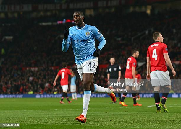Yaya Toure of Manchester City celebrates scoring the third goal during the Barclays Premier League match between Manchester United and Manchester...