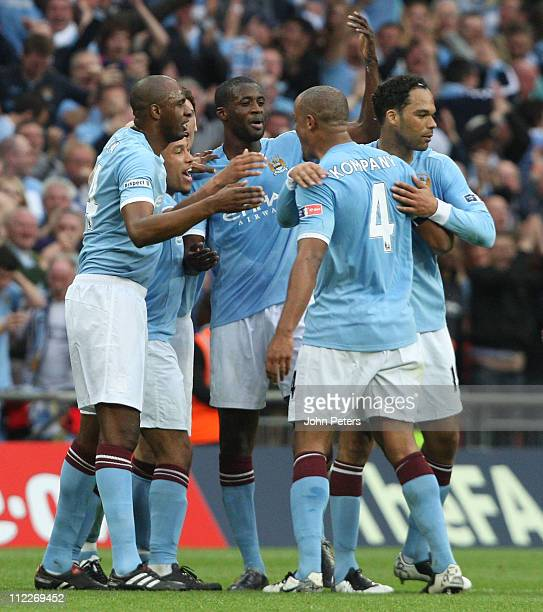 Yaya Toure of Manchester City celebrates scoring their first goal during the FA Cup sponsored by Eon SemiFinal match between Manchester United and...