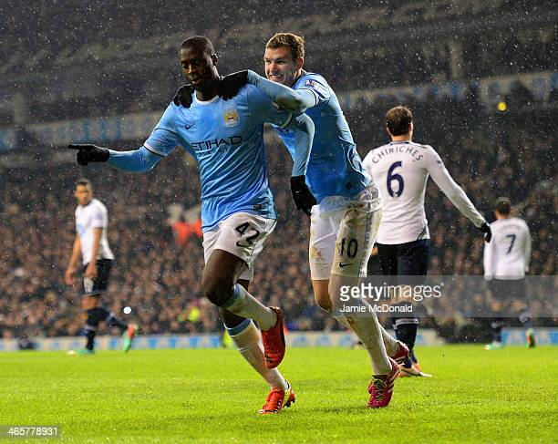 Yaya Toure of Manchester City celebrates scoring their second goal from the penalty spot with Edin Dzeko of Manchester City during the Barclays...
